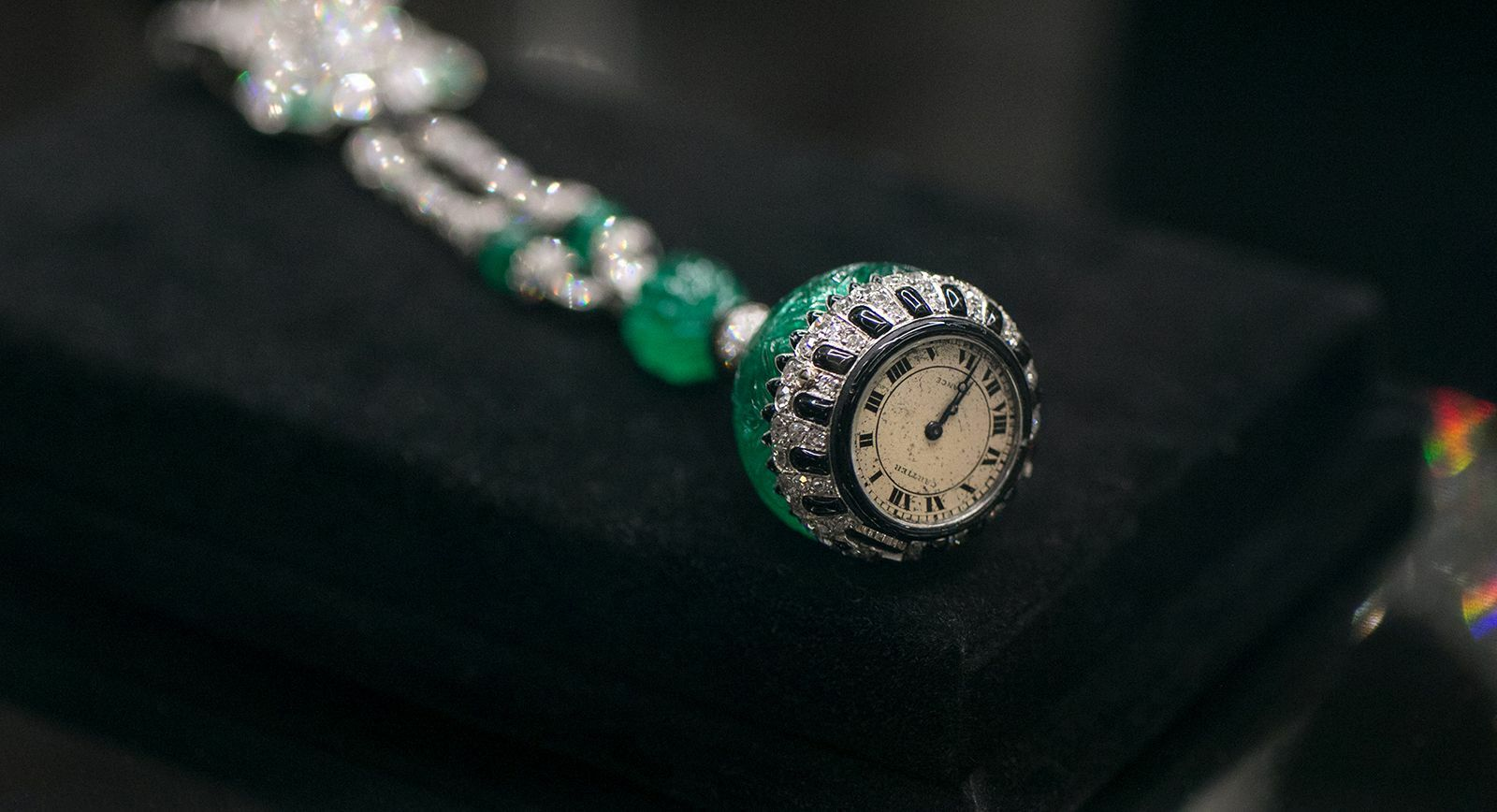 Christie's 'Maharajas & Mughal Magnificence' Cartier lapel watch with emerald, diamond, onyx and enamel