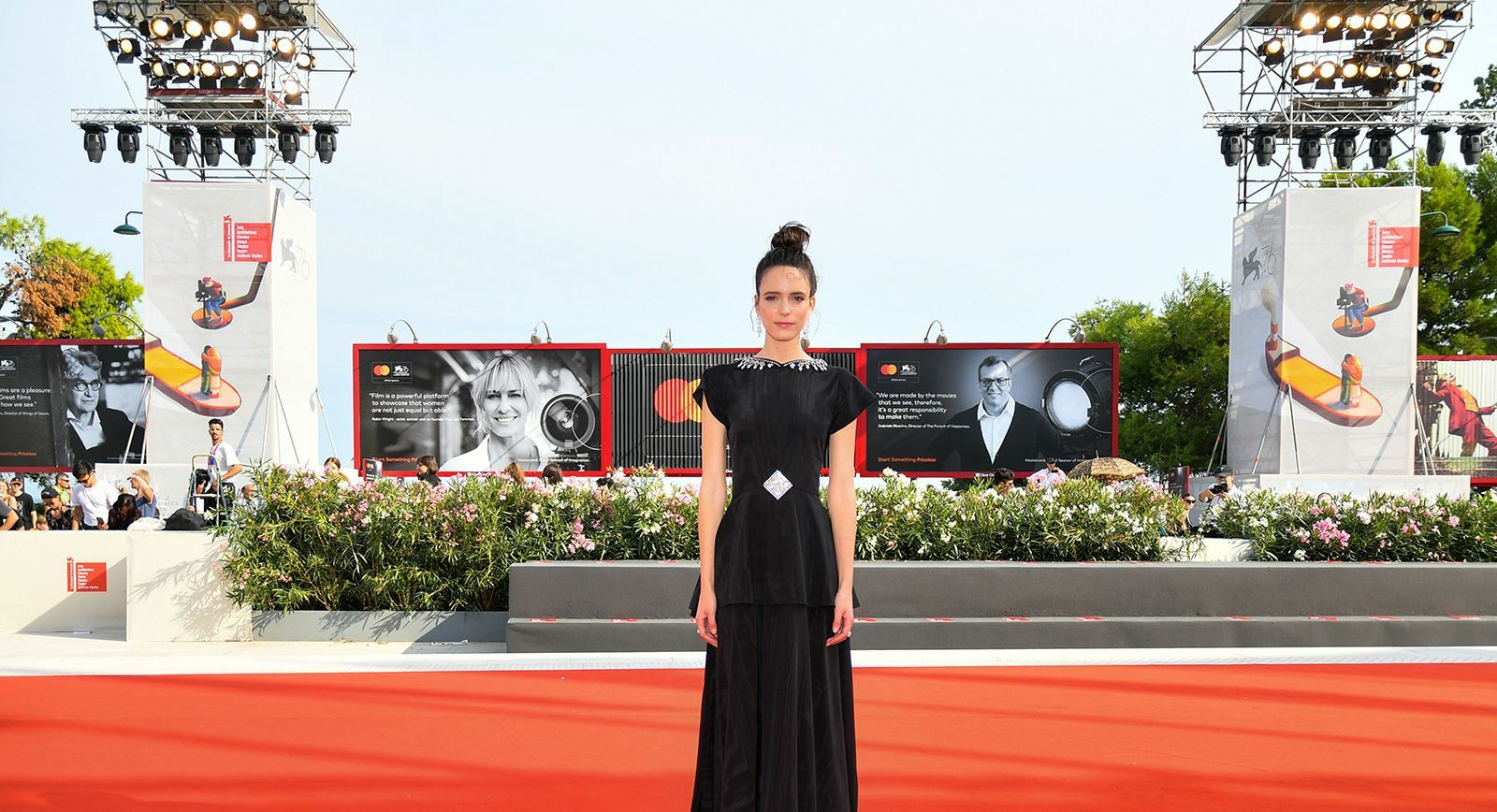 Stacy Martin wearing David Morris diamond earrings at Venice Film Festival red carpet
