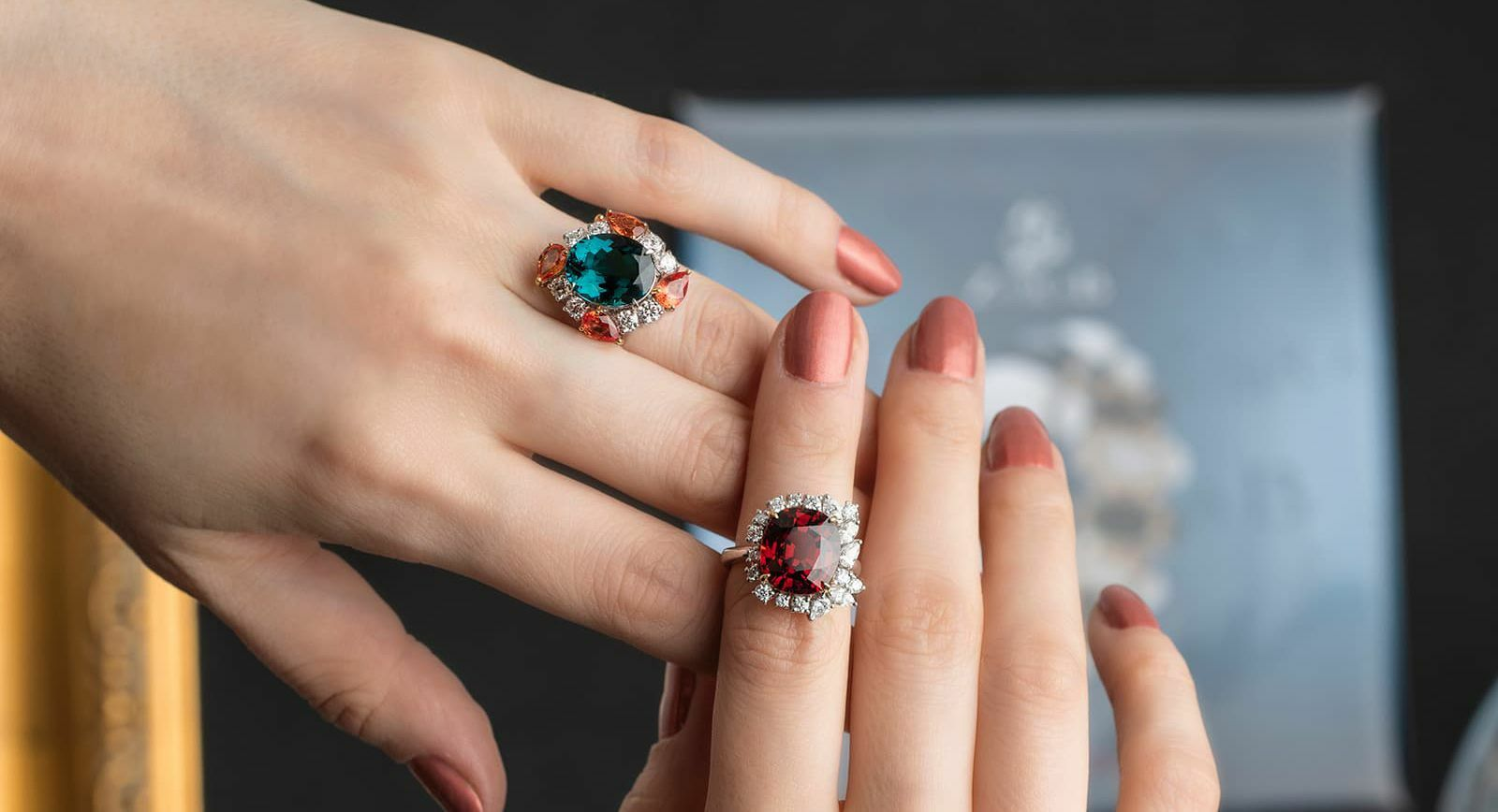 Jessie Foo Yuli Jewellery blue tourmaline ring with padparadscha sapphires and diamonds and spessartite garnet ring with diamonds