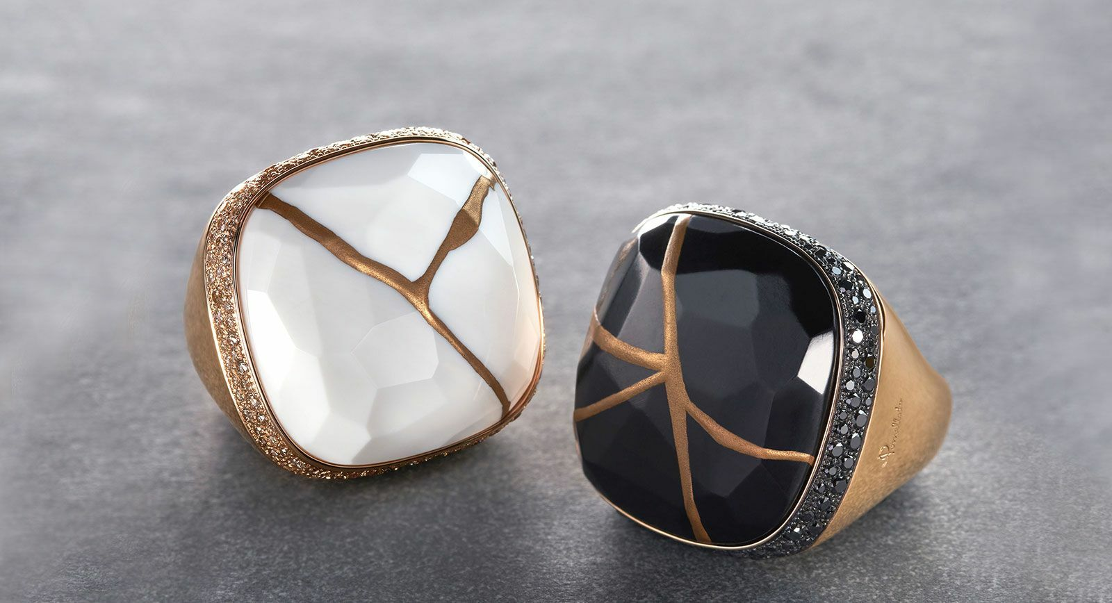 Pomellato Kintsugi collection cocktail rings with jet and kogolong (cacholong) in gold