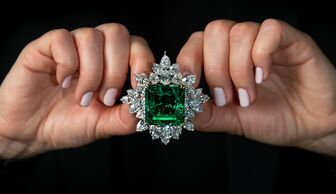 S1x1 emerald and diamond brooch pendant   set with an 80.45 carat step cut emerald of colombian origin   est. us  2.5 3.5m  2