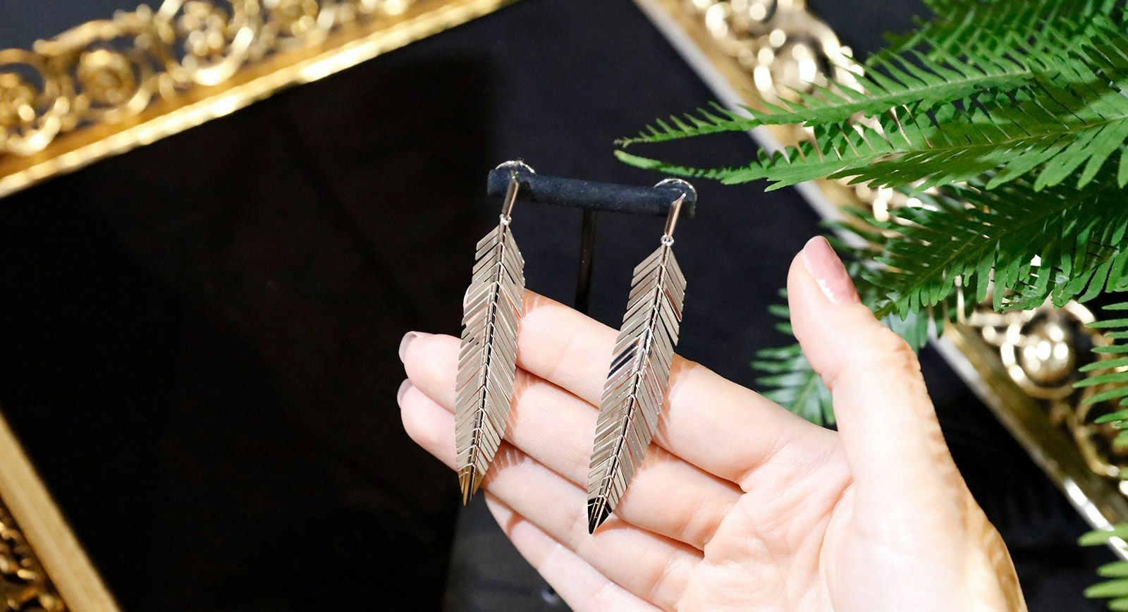 CADAR feather earrings from the Second Skin collection