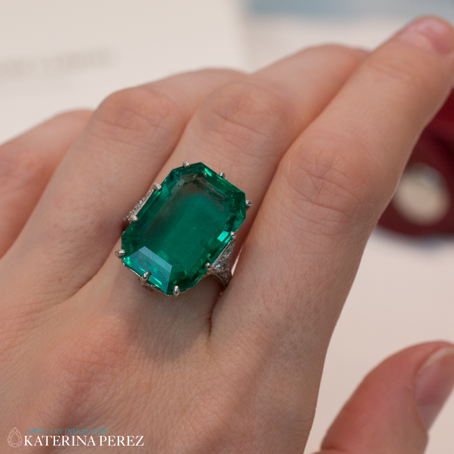 Art Deco Single Stone Emerald Ring, Circa 1920. Featuring step-cut emerald, weighing 14.70 carats and decorated with rose cut diamonds