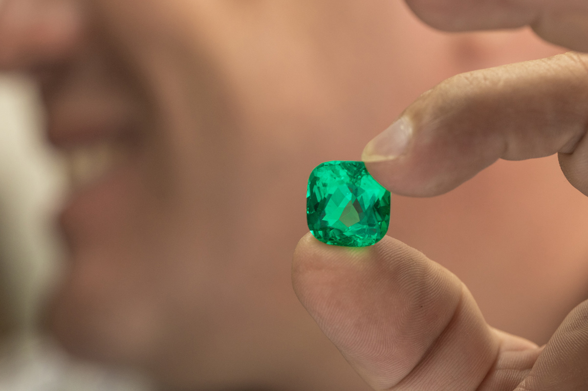 International Emerald Exchange cut and polished Colombian emerald of cushion shape. Photo credit: Juan Cristobal Cobo