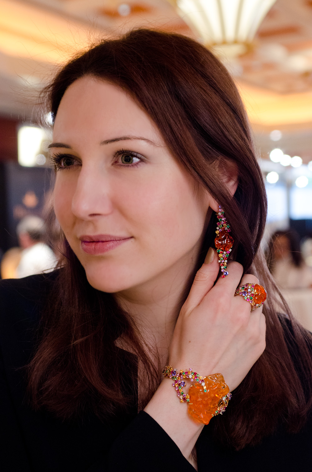 Katerina Perez wearing Mauro Felter Path of Flowers jewellery set with fire opals