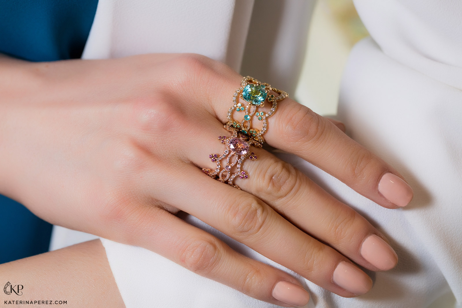 Erica Courtney Crown bands and rings in pink sapphire and paraiba tourmaline. Photo by Simon Martner.