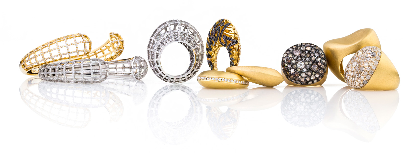 Nada G rings and bracelets in yellow and white gold with diamonds