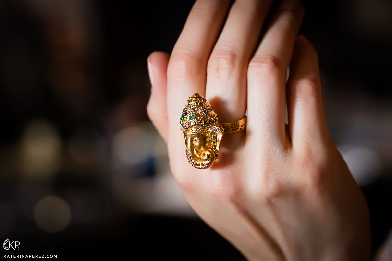 Buddha Mama Ganesh ring in yellow gold with coloured gemstones and diamonds.  Photo by Simon Martner