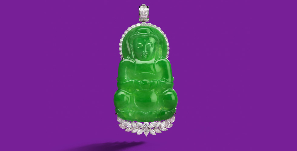 A jadeite and diamond 'Guanyin' pendant with fine translucent carved jadeite (no resin). 'Guanyin' of a rich bright green colour is meditating on a lotus throne, embellished by marquise, pear and brilliant-cut diamonds of approximately 7.60 carats total. Est. $ 350,000 – $ 450,000
