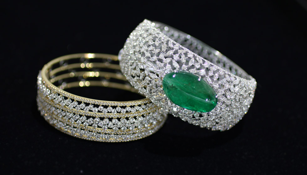 Bapalal Keshavlal bracelets in white and yellow gold with diamonds and an emerald cabochon