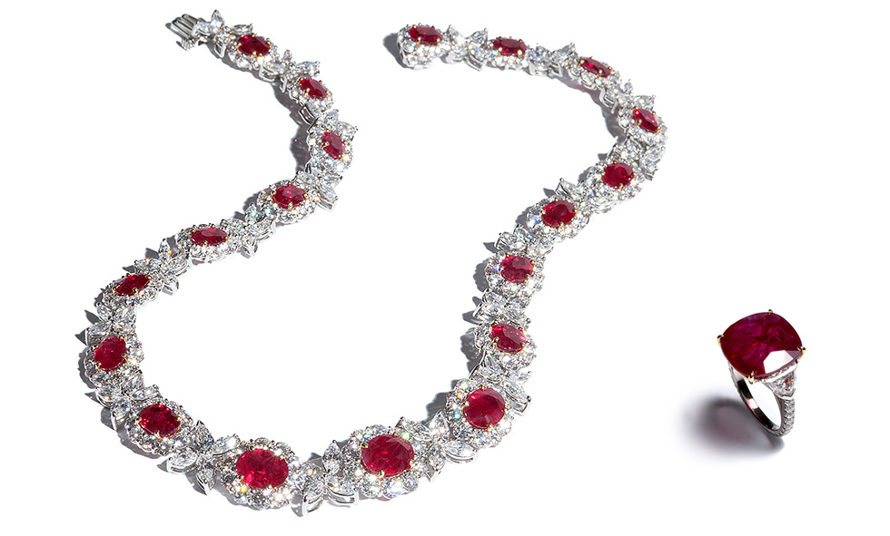 "LEFT: Ruby Necklace with 19 oval ""pigeon's blood"" Burma rubies weighing 34 carats total and 41 carats of colorless diamonds; RIGHT: Ruby Ring with a 10 carat cushion Mozambique ruby flanked by epaulet diamonds with diamond mircopave on the shank"