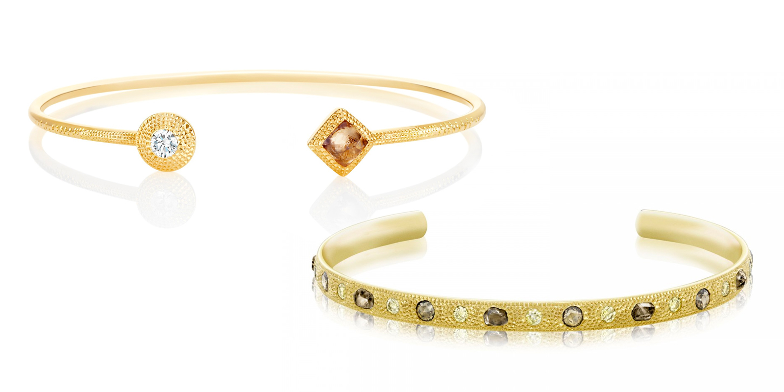 De Beers Talisman collection open bangles in yellow gold with rough and faceted diamonds