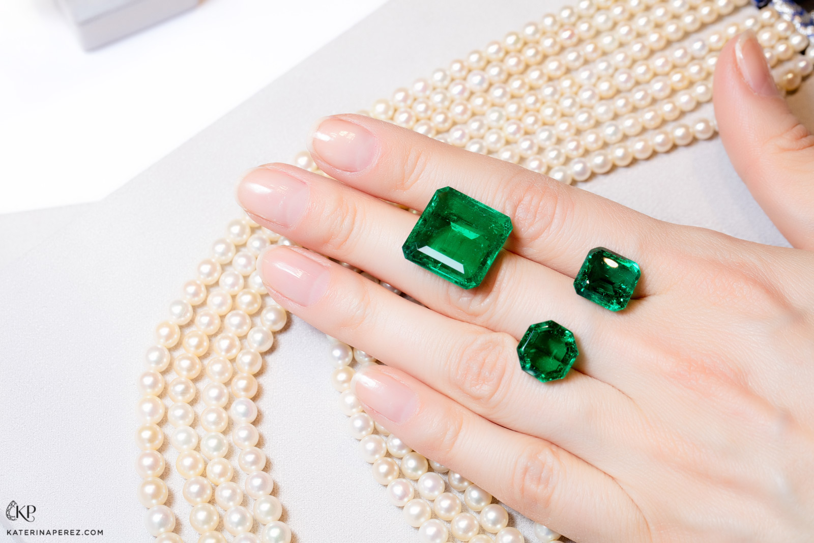 Emeralds cut and polished at Dharmendra Tank's factory in Jaipur. Photo by Simon Martner.