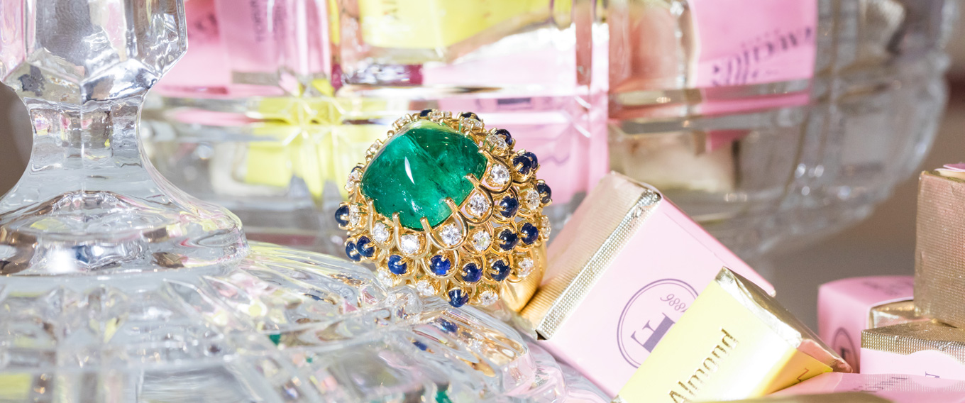 Veschetti ring with a sugar loaf emerald, sapphires and diamonds set in yellow gold. Photo by Simon Martner for katerinaperez.com
