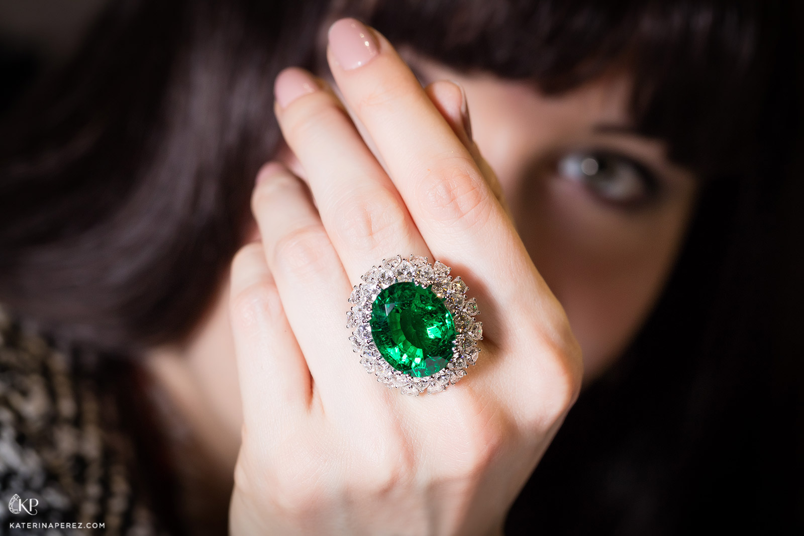 Picchiotti bombé ring with 19ct Zambian emerald and pear cut diamonds