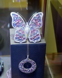 Butterfly with rose cut sapphires and round brilliant diamonds set in white gold by Fraleoni