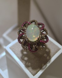 D.Donna cocktail ring with an oval cabochon opal, champagne diamonds and pink sapphires