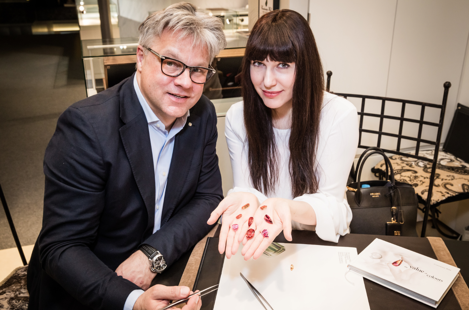 Constantin Wild and Katerina Perez at Baselworld with a handful of Imperial topaz (bottom right, Constantin's book: The Value of Colours)