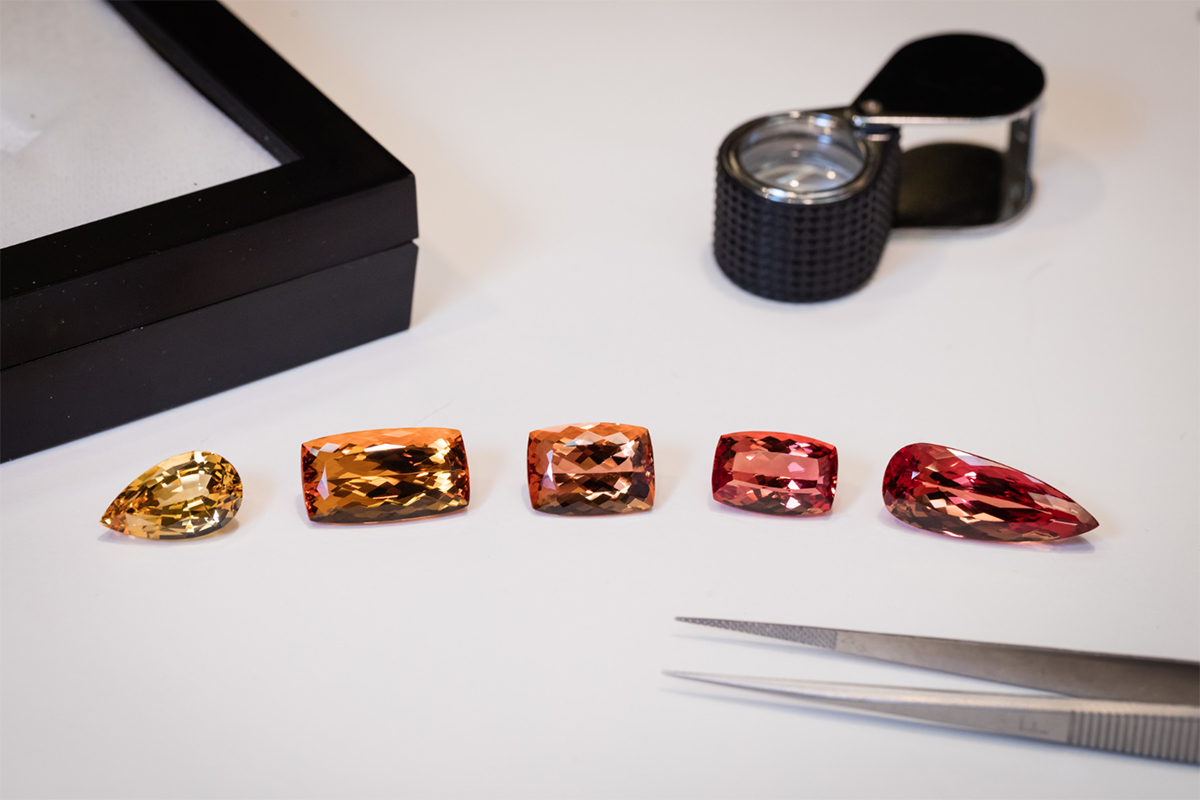 The quality scale of Imperial topaz: from yellow, golden, pinkish-orange, orange-red, to pinkish-red at Constantin Wild