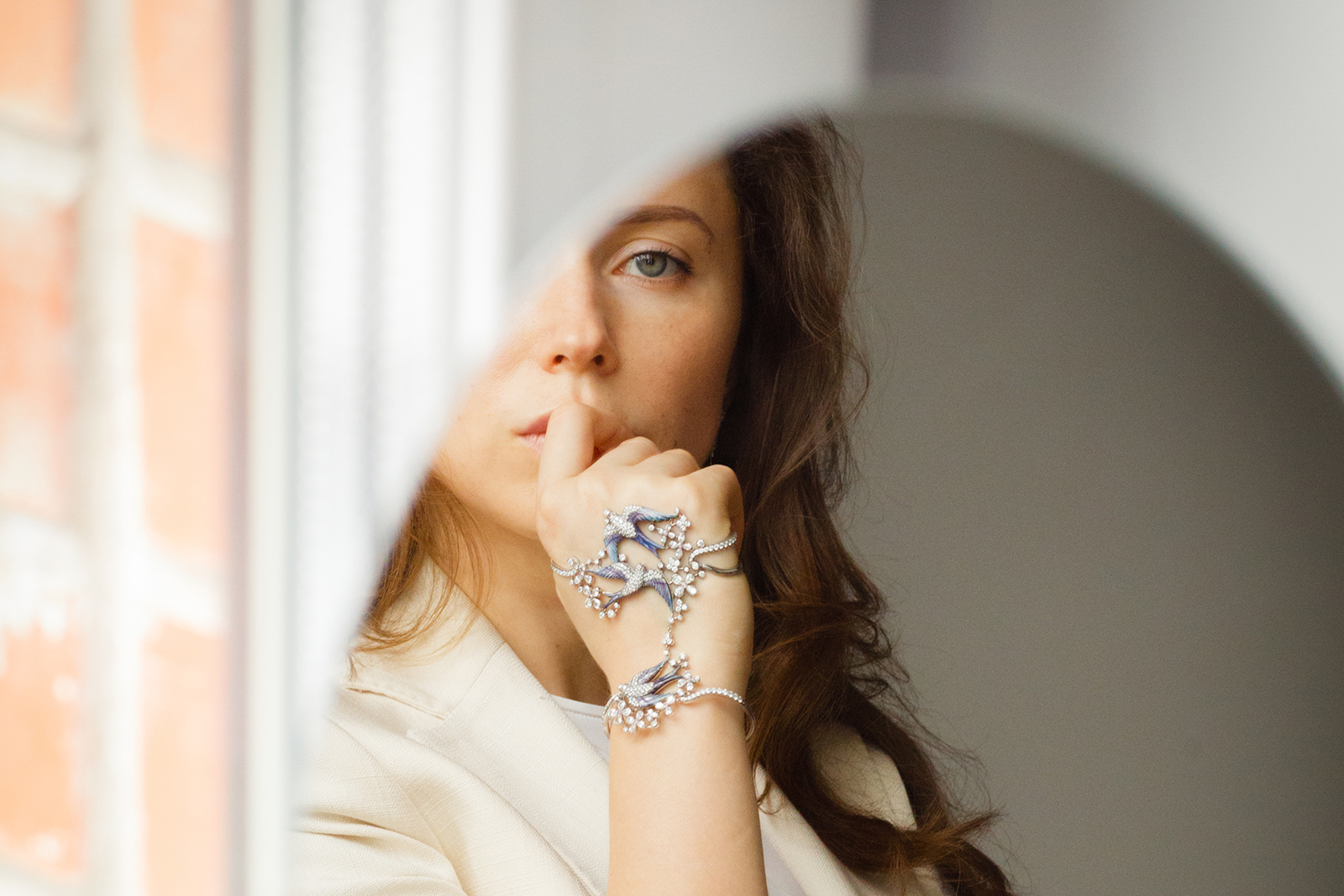 Elizaveta Borzunova, founder of Liza Borzaya in her enamel and diamond 'Swallow' palm bracelet