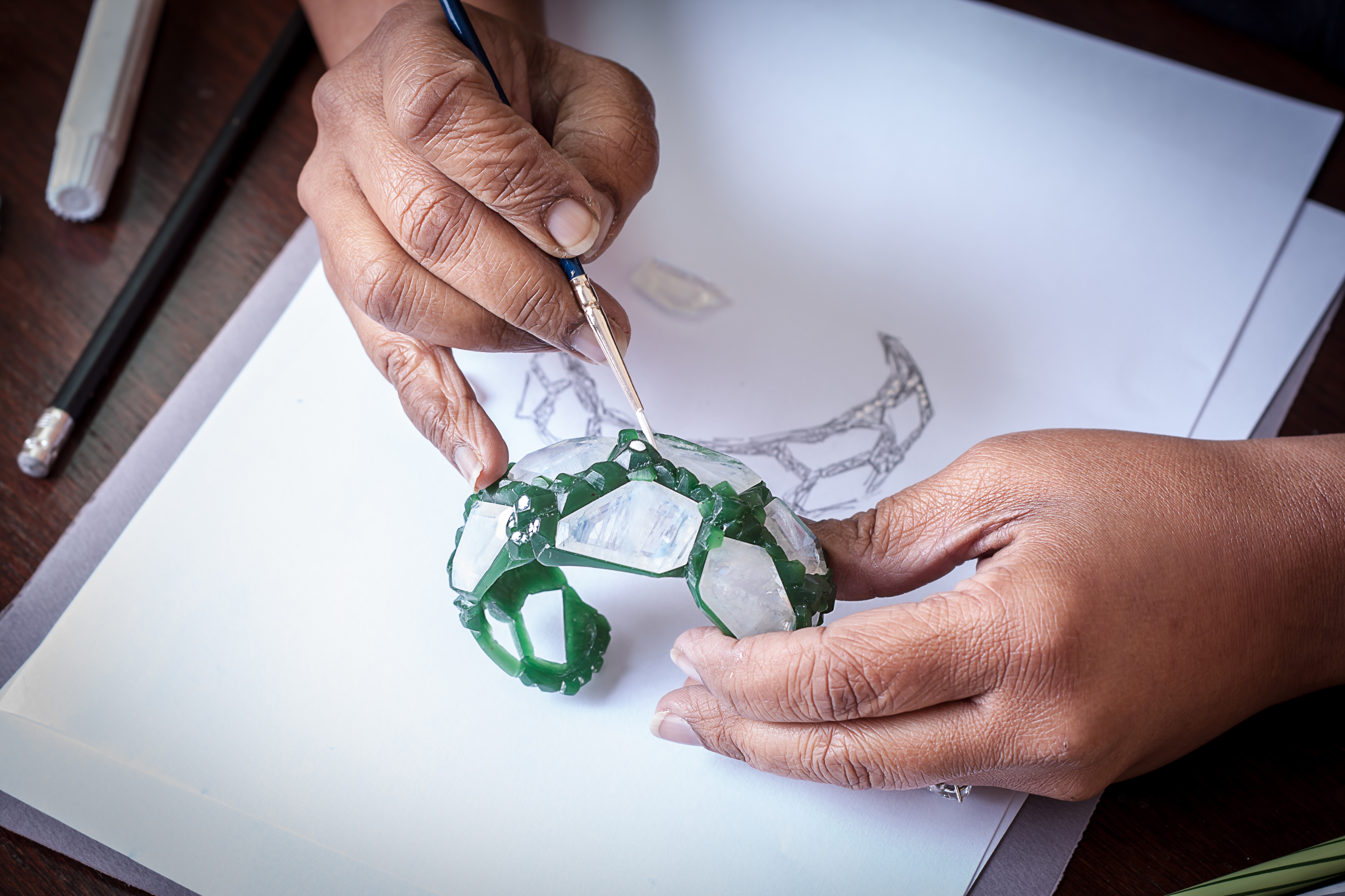 Neha Dani working on the 'Aialik' cuff from the 'Glacier' collection wax model