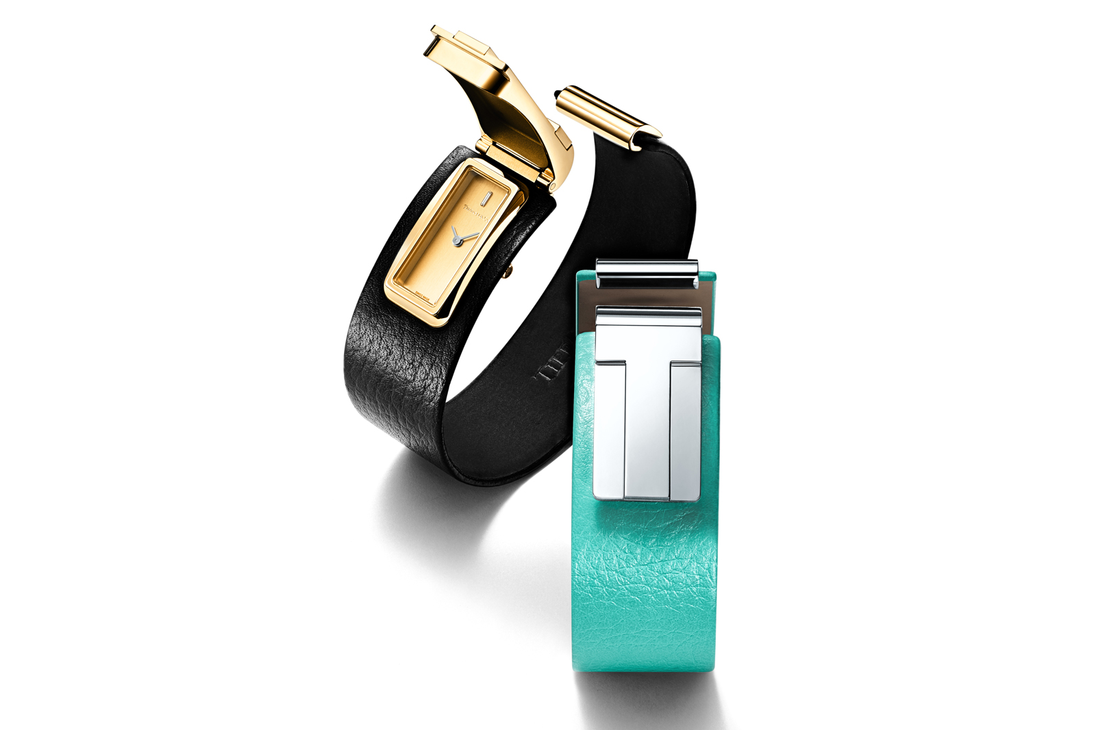 Tiffany & Co. 'Tiffany T' cuff watches in yellow gold and silver