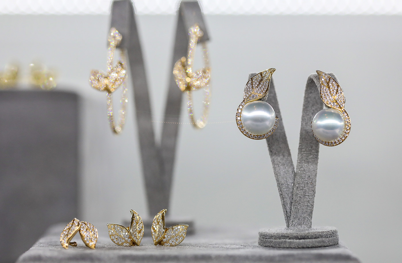 Nadine Aysoy Feuille collection earrings and ea-cuffs in yellow gold, pearls and diamonds