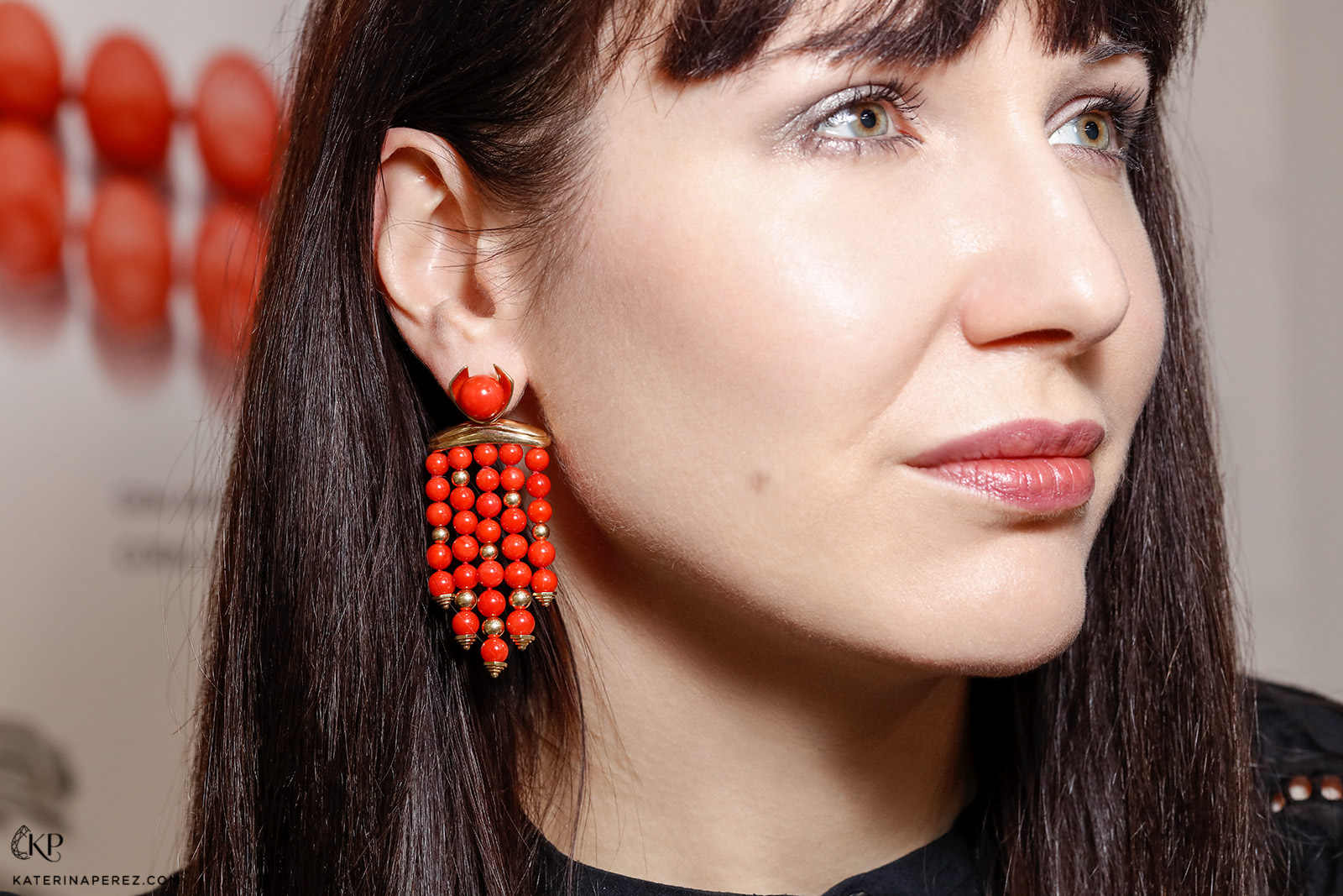 Katerina Perez wearing Assael Sardinian coral and yellow gold earrings