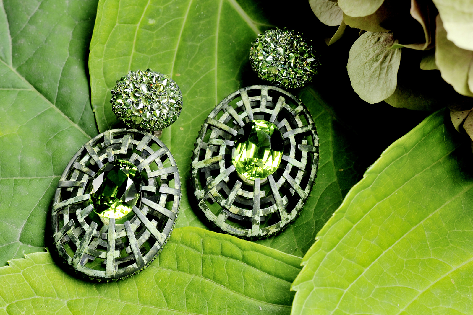 Hemmerle earrings with demantoids, peridots, white gold, silver courtesy of Hemmerle