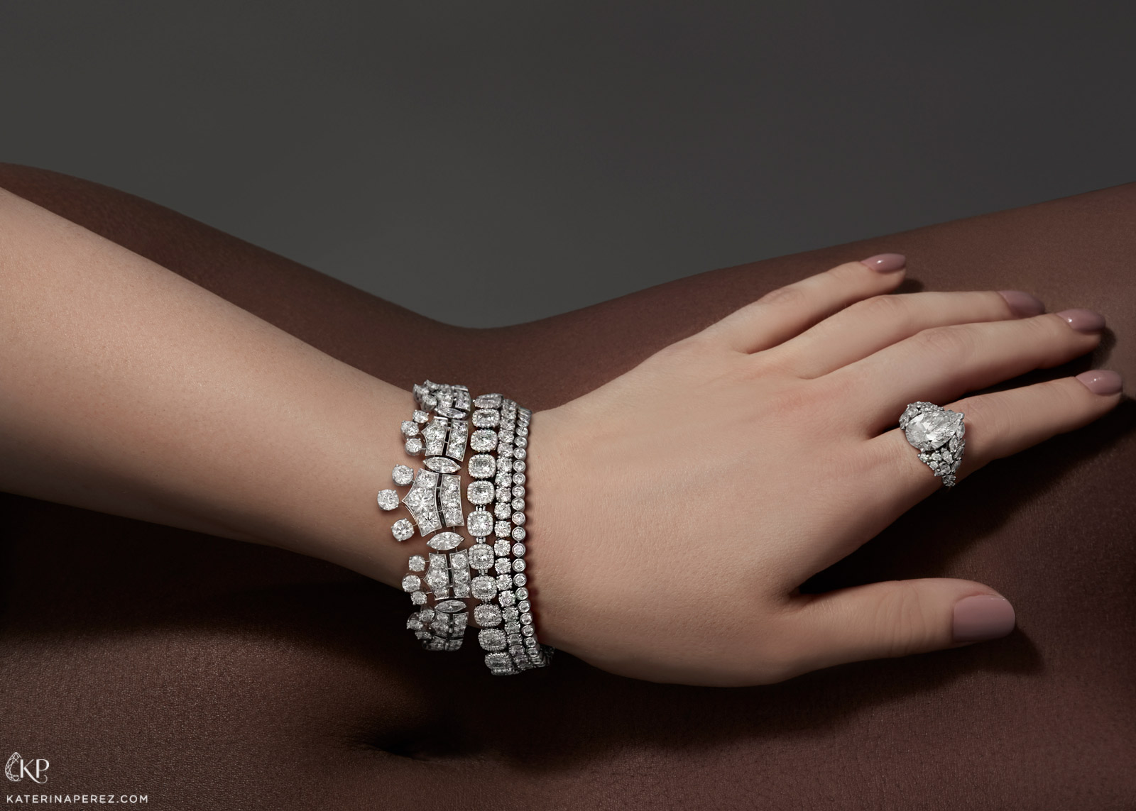 From left to right: De Beers 'Phenomena', 'Aura' and 'Classic Lines' bracelets with diamonds and 'London' ring from the 'Thames Path' collection with pear cut feature diamond and accenting diamonds