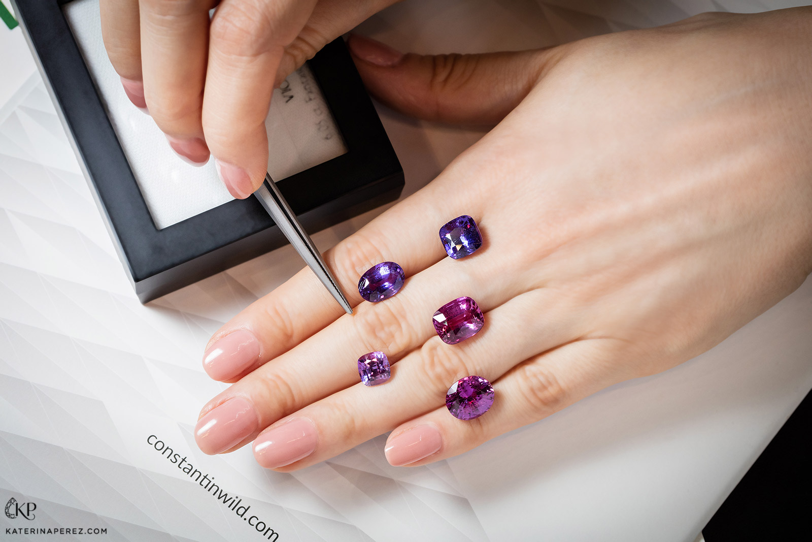 A selection of fancy coloured purple hue sapphires in a variety of cuts from Constantin Wild. Photo by Simon Martner