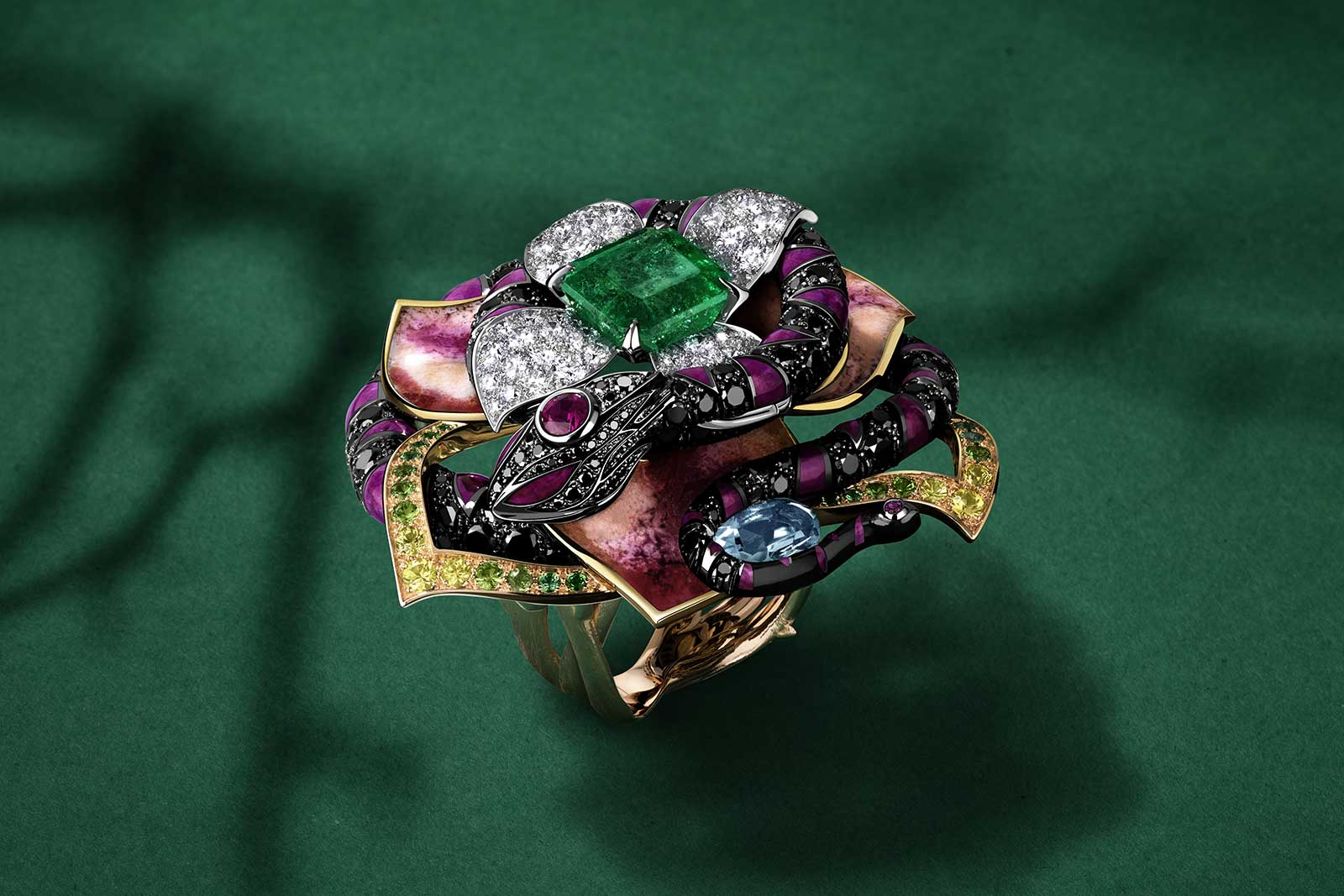 Jewellery Orchestra 'Boa Constrictor' dis-engagement ring with 4 ct Colombian emerald, aquamarine, tsavorites, rubies, colourless and black diamonds and enamel in platinum, 18k yellow, pink and white gold