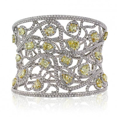A magnificent Avakian cuff bracelet set with fancy yellow diamonds and white diamonds