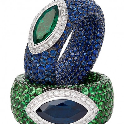 A striking pair of signature Avakian rings set with emeralds,sapphires and diamonds