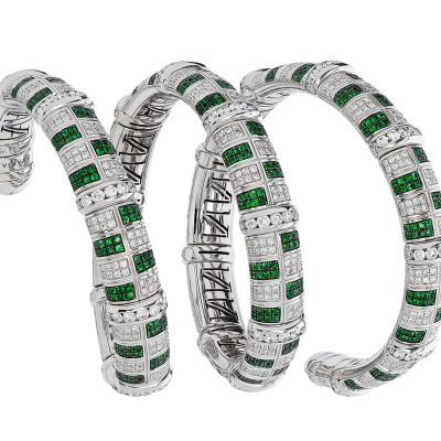A stunning Avakian flexible cuff bracelet set with emeralds and diamonds