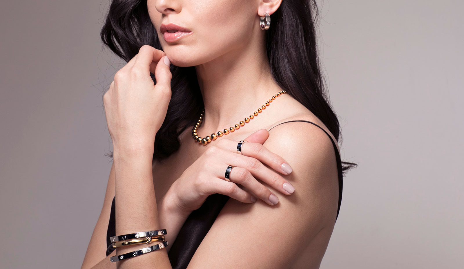 Cartier 'Love' bangles, rings and earrings from Court&Covet in 18k white and yellow gold, and ball necklace in 18k yellow gold