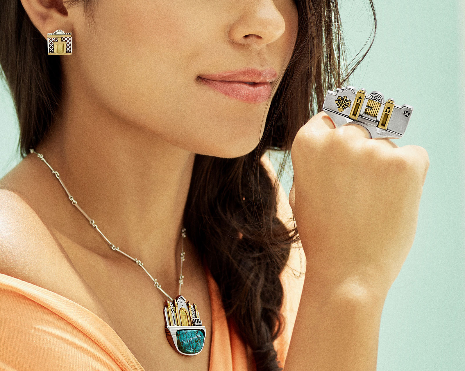 Azza Fahmy's Nubia collection pendant with turquoise, earrings and a ring in yellow gold and silver