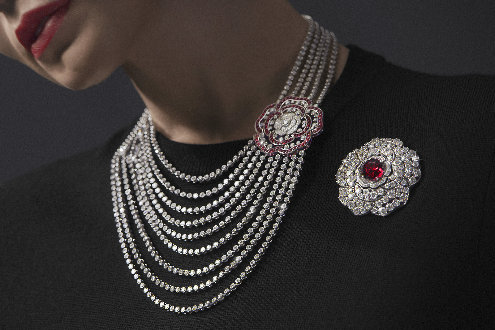 Chanel '1.5. 1 CAMÉLIA . 5 ALLURES' collection 'Rouge Incandescent' transformable necklace, in white gold, rubies and diamonds. Detachable camellia motif that may be worn as a brooch, and reveals another openwork camellia motif