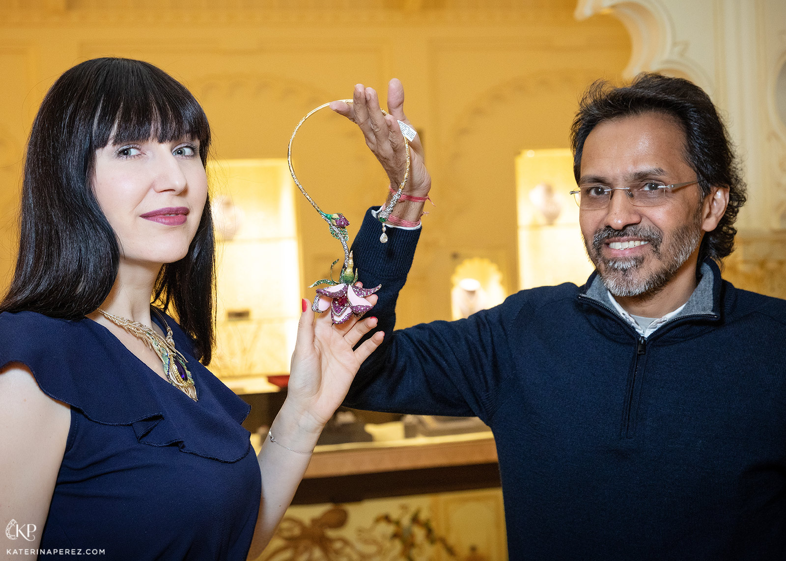 Katerina Perez and Anup Bohra of Masterstrokes with the 'Aphrodite' necklace featuring 158.55ct of pink conch shell, central 4.41ct ruby and accenting rubies, emeralds, tsavorites and diamonds in champlevé enamel