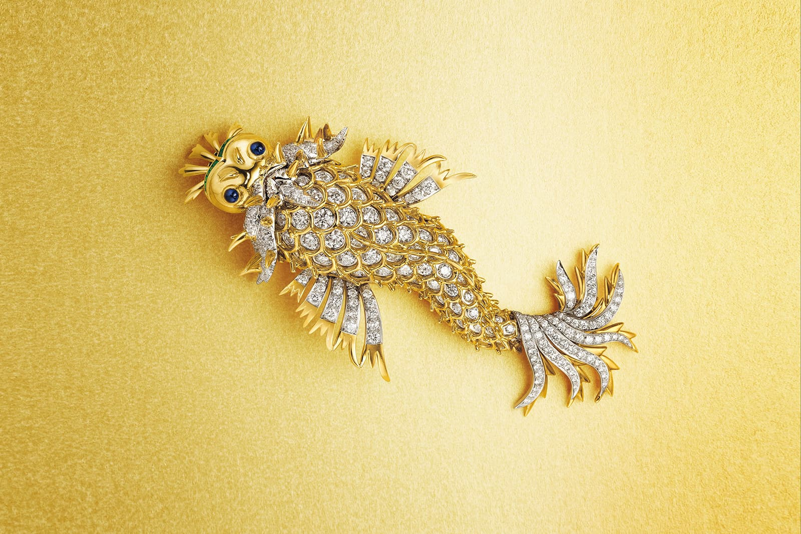 A charming 'Dolphin' brooch with diamonds, sapphires and emeralds by Jean Schlumberger