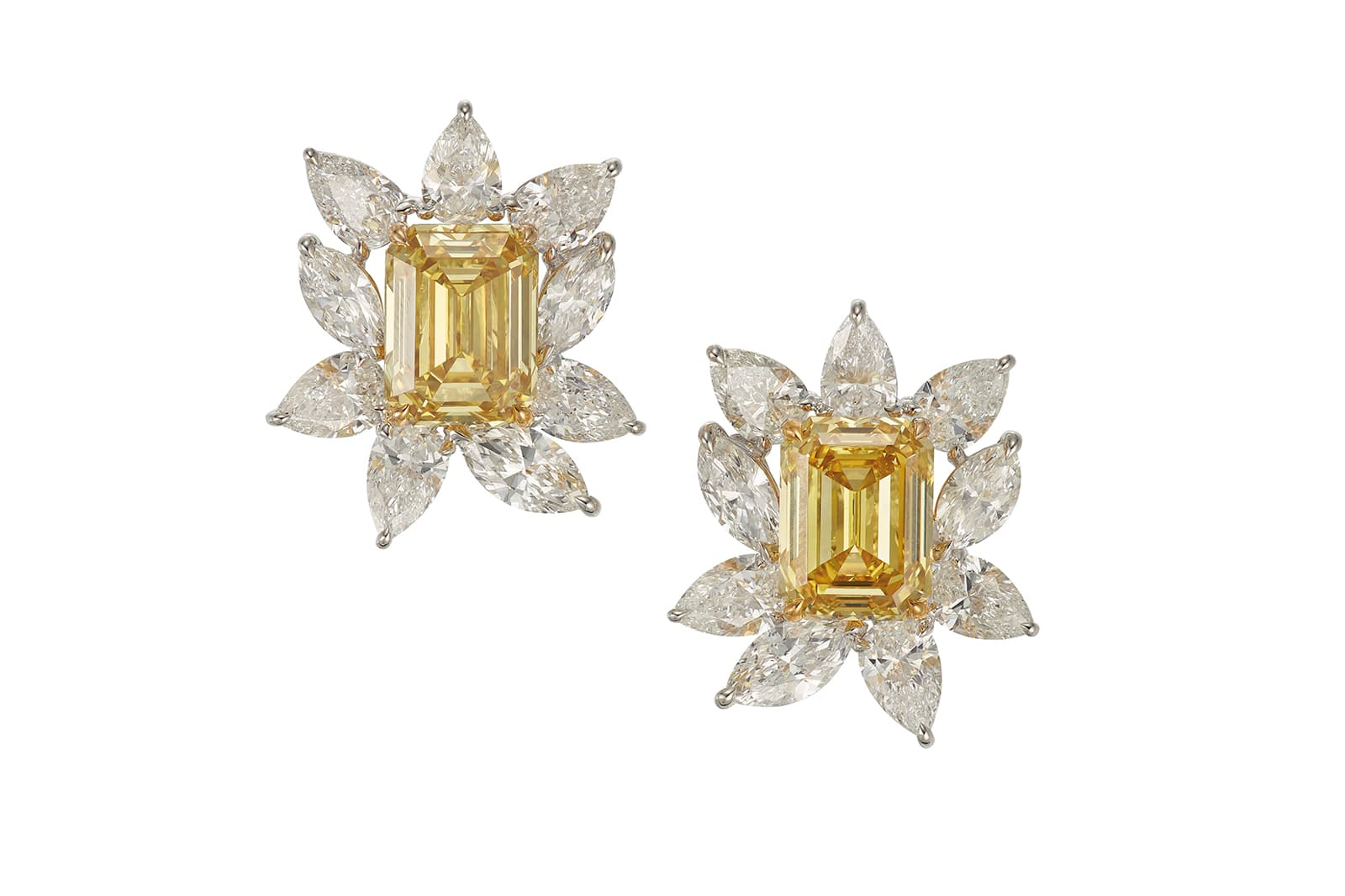 A pair of fancy deep yellow diamond earrings of 7.55 carats and 7.51 carats