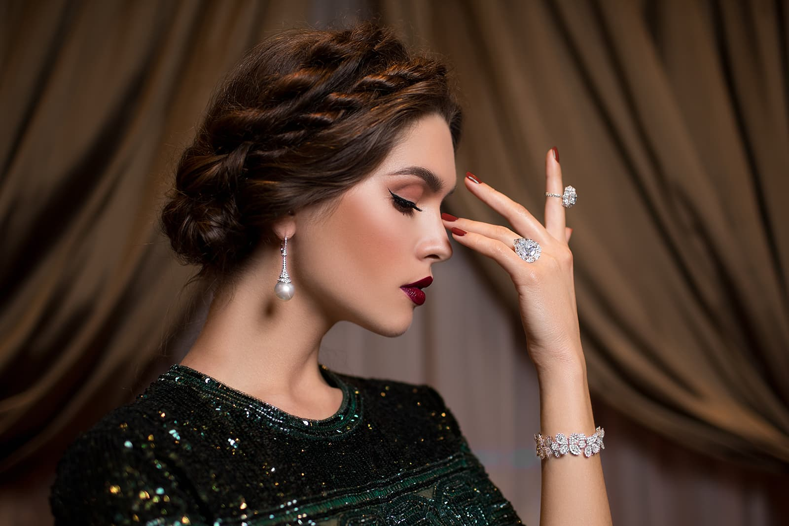 A suite of MaximiliaN London jewellery including a drop earring with pearl, cocktail rings and bracelet, all with diamonds