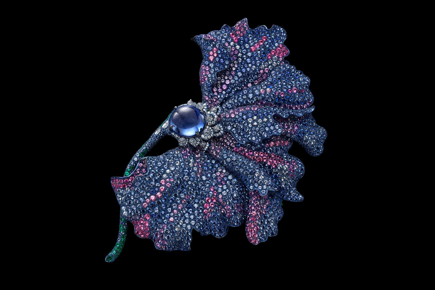 Carnet brooch with an unheated oval blue sapphire cabochon, pink, purple and blue sapphires, emeralds and diamonds set in titanum and 18K white gold