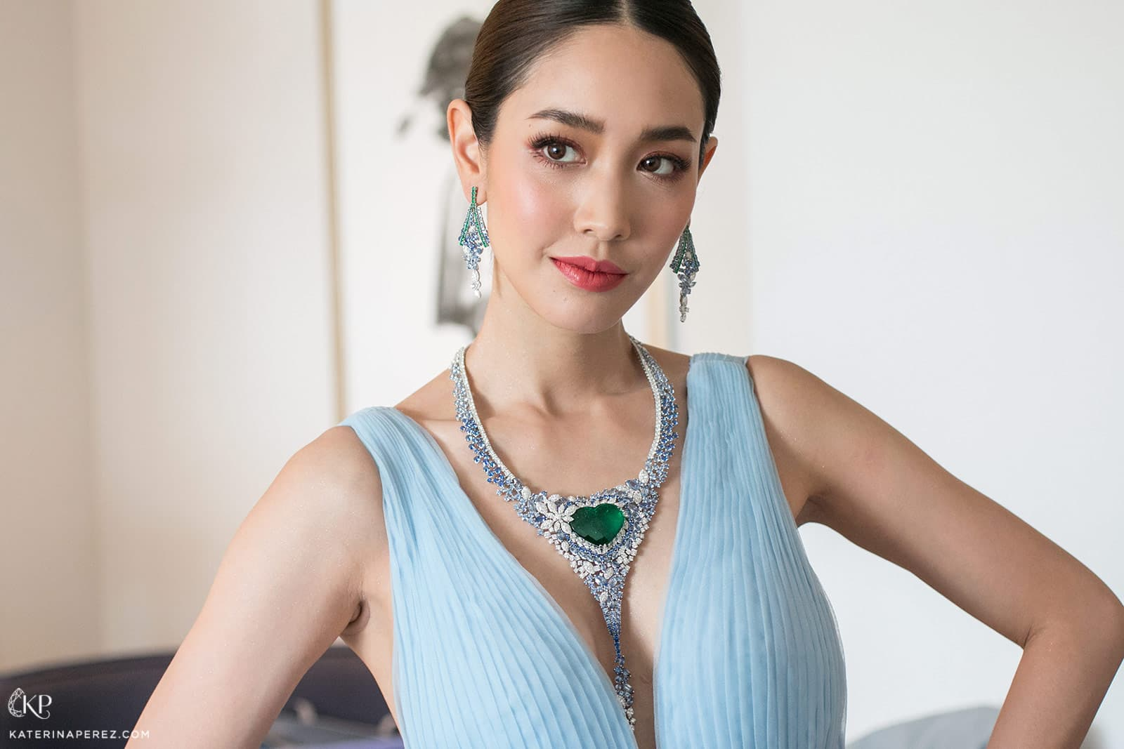 Pechaya Wattanamontree wearing AVAKIAN earrings and necklace with 40ct heart shaped Colombian emerald, diamonds and sapphires