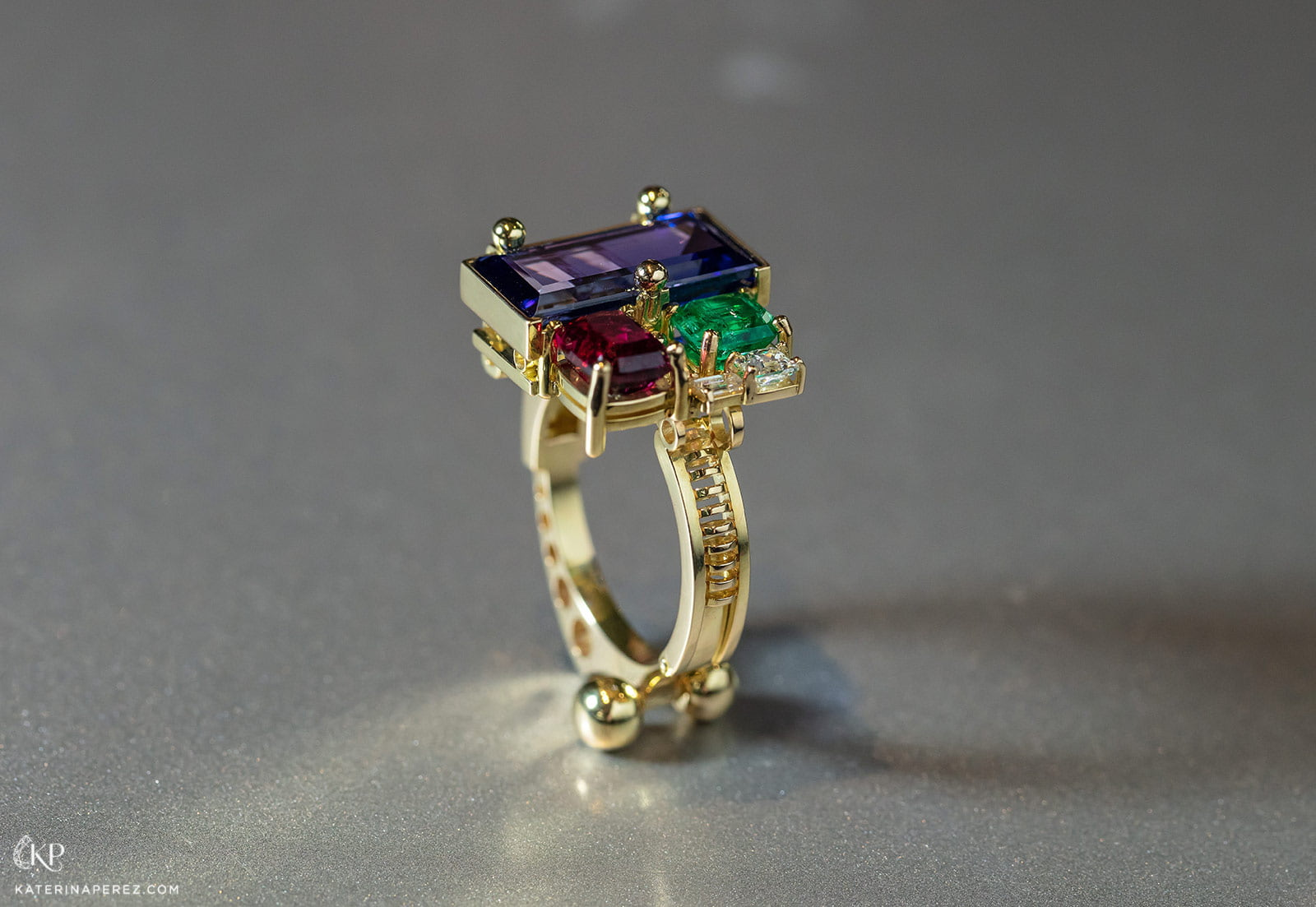 Milio Supremus ring with tanzanite, emerald, ruby and diamonds set in yellow gold