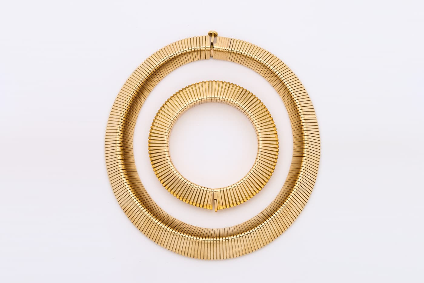 Cartier bracelet and necklace in yellow gold offered by A La Vieille Russie