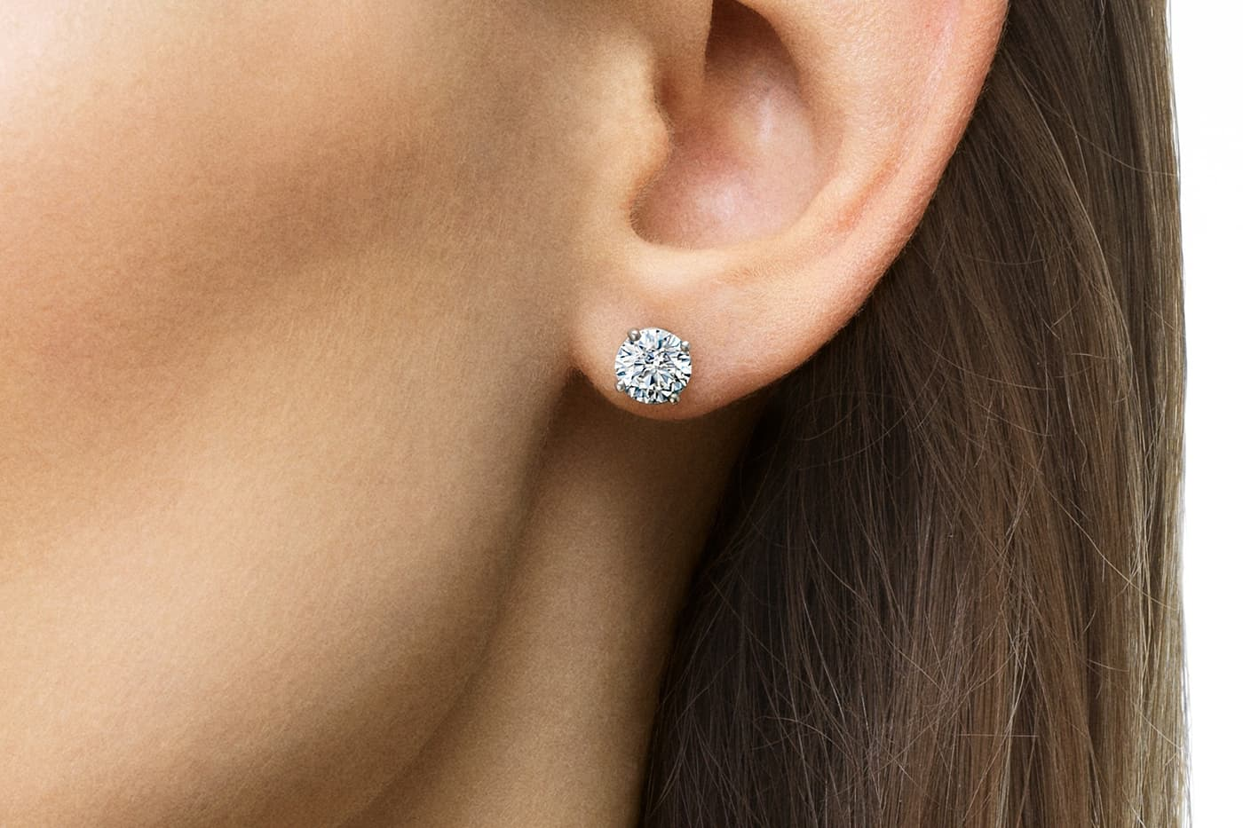 De Beers 'Classic' stud earrings with diamonds in white gold