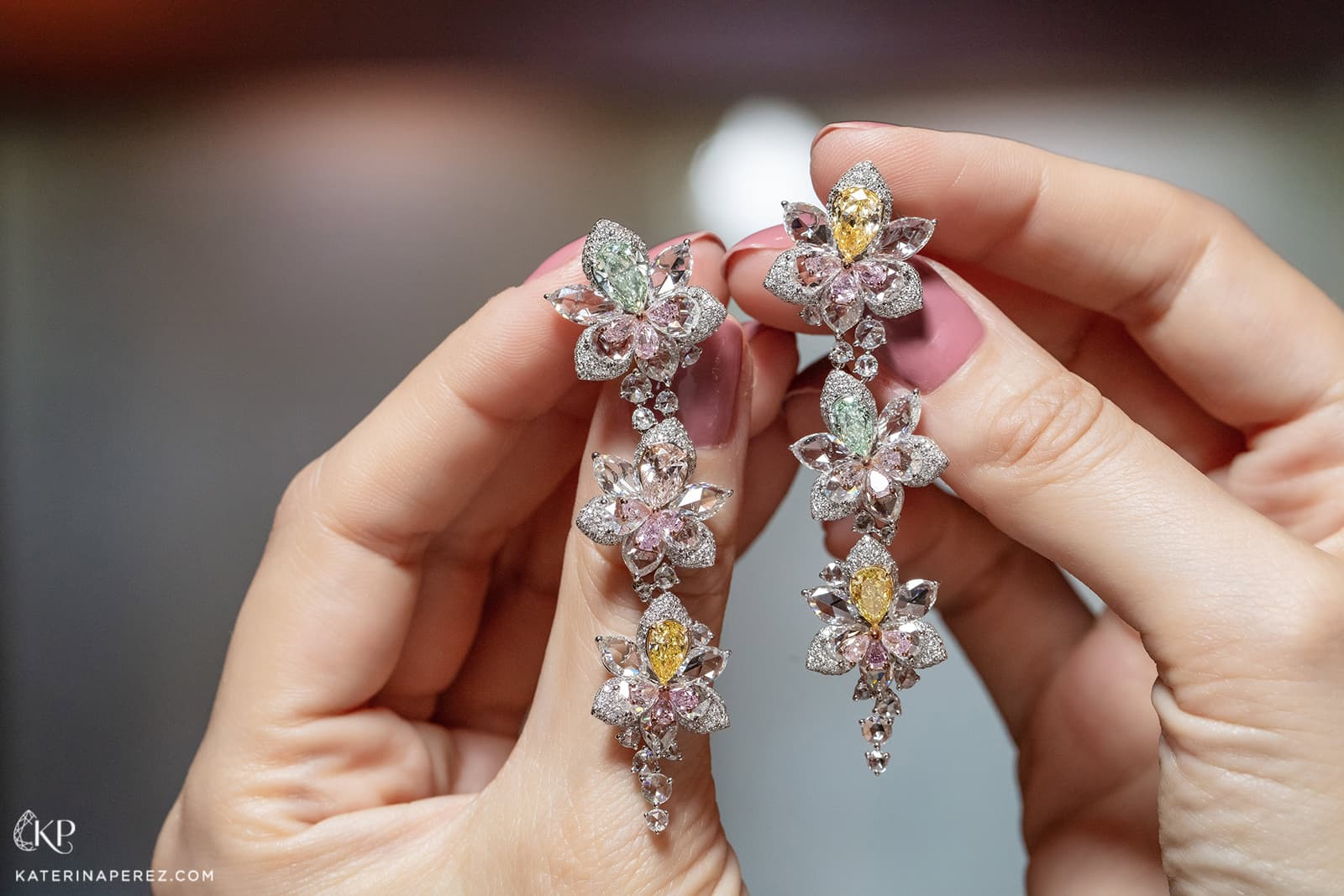 Novel Fine Jewelry earrings with fancy coloured diamonds and colourless rose and brilliant cut diamonds in white gold
