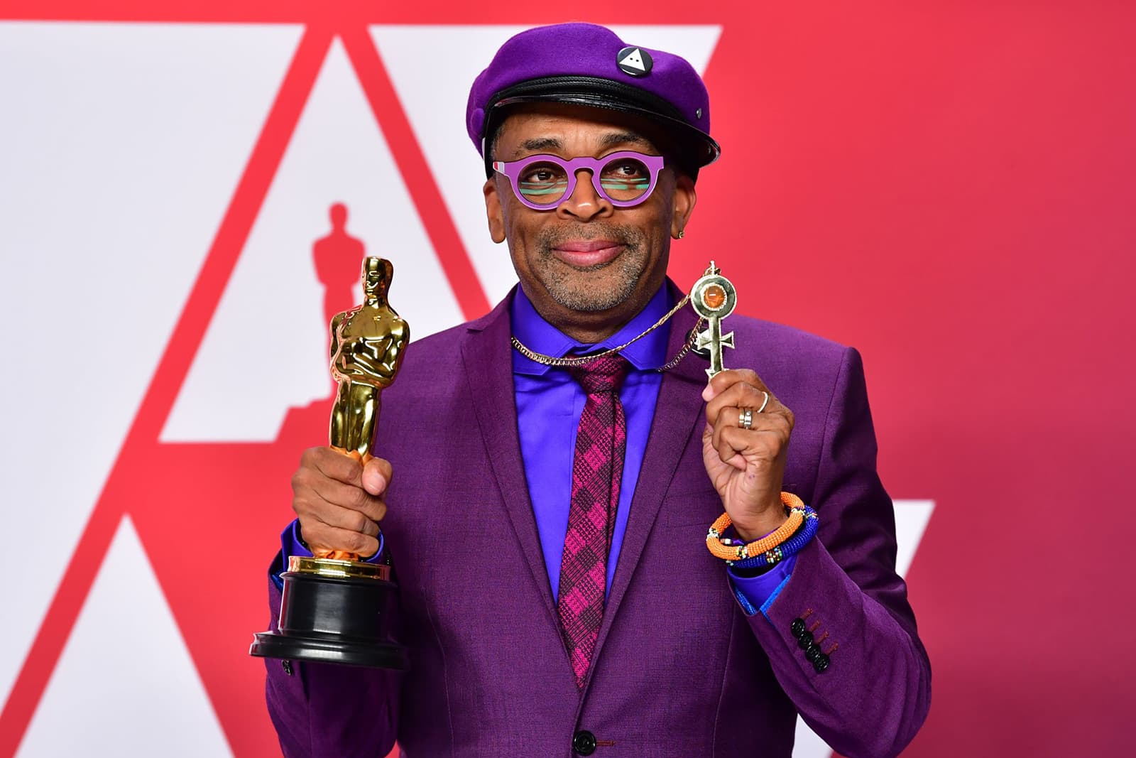 Spike Lee wearing Amedeo Scognamiglioa bespoke pendant with diamonds and fire opal in yellow gold