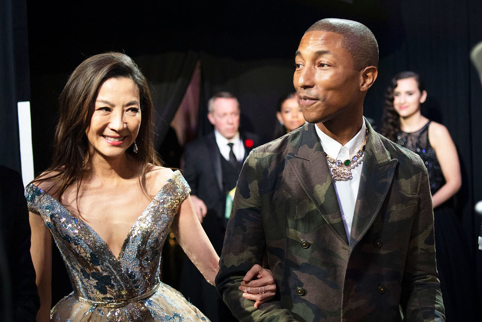 Pharrell Williams wearing Jacob & Co. necklace with diamonds, emeralds and sapphires in yellow gold, and bespoke Chanel necklace with pearls and diamonds in white gold